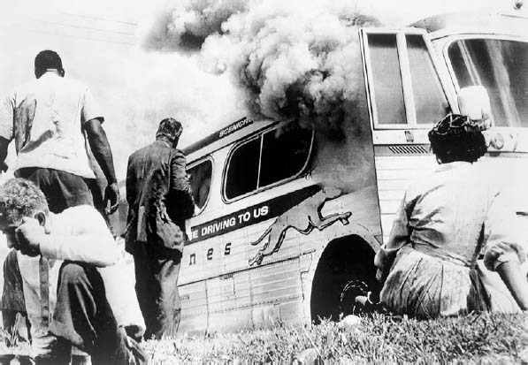 A bus carrying civil rights Freedom Riders is fire-bombed during a caravan to advocate black voting rights in 1961. The Freedom Riders were civil rights advocates, both black and white, who traveled to the South from the North on buses in 1961 as