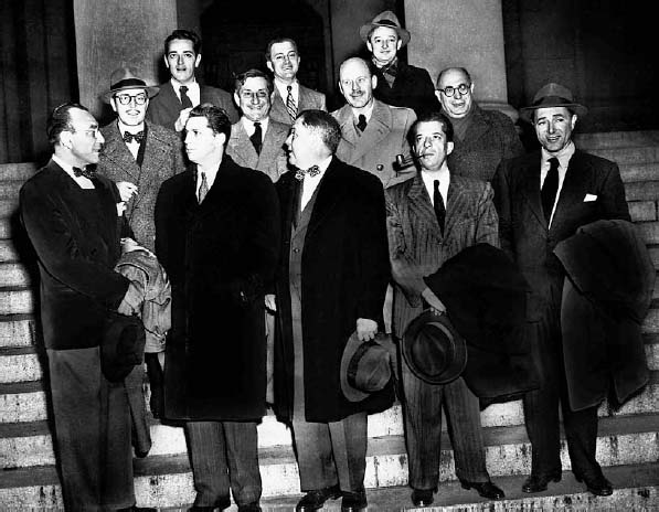 "Ten Hollywood personalities, the ""Hollywood 10,"" stand with their attorneys outside district court in Washington, D.C., before arraignment on contempt of Congress charges, January 9, 1948. The ten were charged for"