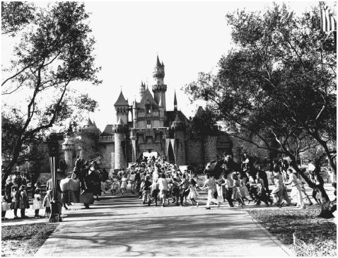 Disneyland. Children dart through the entrance to Fantasyland during opening day at Disneyland in Anaheim, California on 17 July 1955. © AP/Wide World Photos