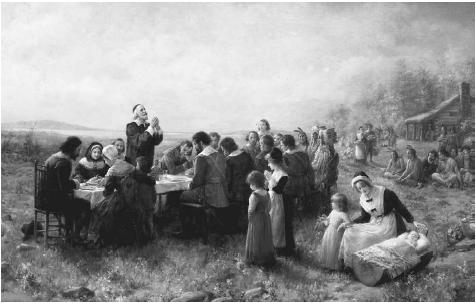 The First Thanksgiving at Plymouth, Massachusetts. An oil on canvas painting by Jennie Augusta Brownscombe (1850–1936) in 1914, The First Thanksgiving at Plymouth, Massachusetts depicts the peaceful gathering of the English settlers and Native Americans. © The Granger Collection Ltd.