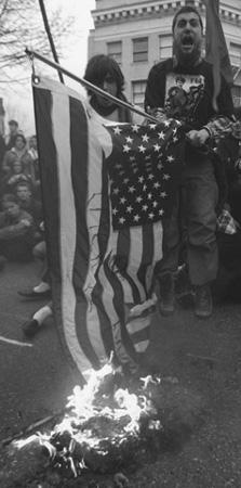 Antiwar demonstrator burning an American flag, Portland, Oregon, March 20, 2003.
