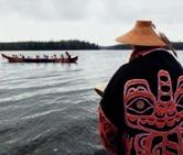 Haida man in a bark hat and button cloak