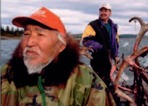 Inupiat men returning with a caribou caught in Kobuk Valley National Park