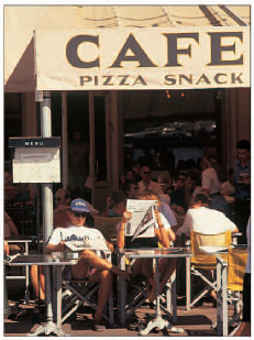 Relaxing in the sun at a traditional French caf