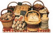 Tempting display of charcuterie and cheeses on a Lyon market stall