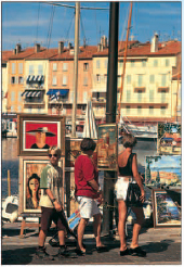 Admiring the work of local artists on the quayside at St-Tropez