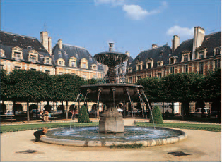 Central fountain and fine Renaissance houses in the Place des Vosges