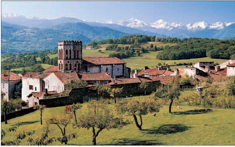 A picturesque village set in a lush valley among the foothills of the Pyrenees mountains