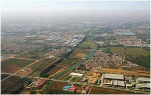Smog hangs over farmland outside of Beijing, China, 2006.