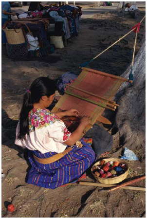 A woman weaving on a Mayan loom. Mayan, Aztec, and Incan clothing were often ready to wear straight off the loom.