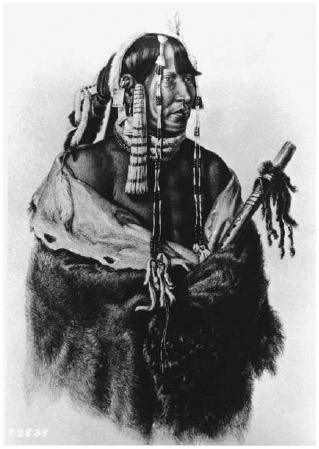 A man wearing a cloak made out of animal skin. Cloaks could be made of antelope, buffalo, deer, rabbit, or other animal skin.