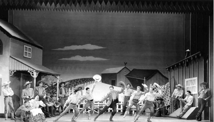 Performance of Rodgers and Hammersteins musical Oklahoma! on Broadway 19431948, directed by Rouben Mamoulian. The musical epitomizes the development of the book musical and Rodgers and Hammerstein were awarded a