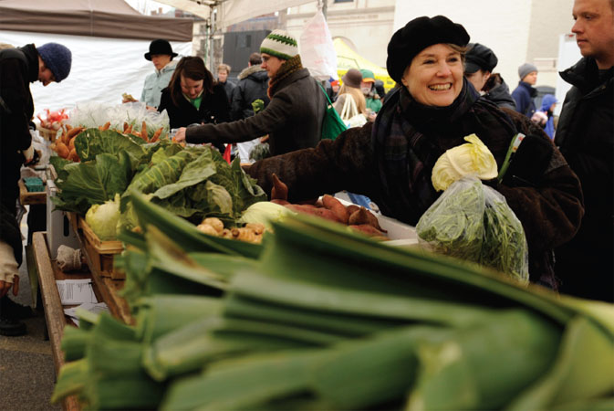 Alice Waters, the executive chef and owner of Chez Panisse in Berkeley, California, looks over the produce at a farmers market in Washington, 2009. Waters has been advocating the use of seasonal, local food since the 1960s.