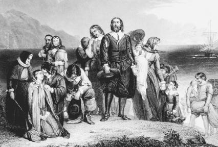 Pilgrims, some of the earliest English colonists, arrive at Plymouth Rock in Massachusetts in 1620. Reproduced by permission of Getty Images.