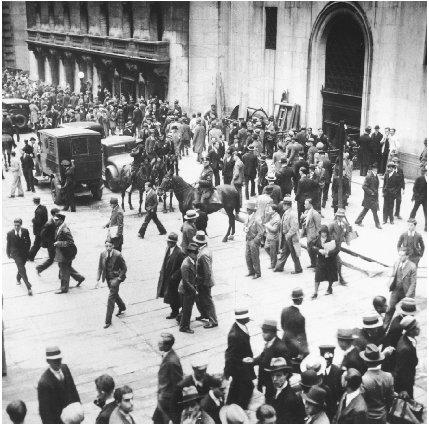 Crowds move past the New York Stock Exchange Building in New York City on October 24, 1929, the day the stock market plunged. AP/Wide World Photo. Reproduced by permission.