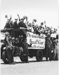 World War I veterans make the long trek to Washington, D.C., to demand payment of the soldiers' bonus. AP/Wide World Photos. Reproduced by permission.