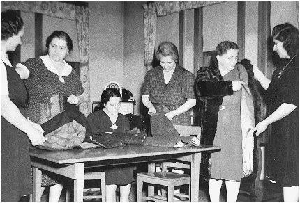 """In order to """"make do"""" with less, many women sewed their own clothing instead of purchasing clothes from stores. Courtesy of the Franklin D. Roosevelt Library."""