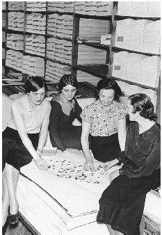 Four women put together a jigsaw puzzle while on break from work. AP/Wide World Photo. Reproduced by permission.