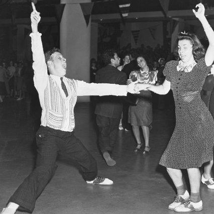 Two teenagers dance the jitterbug during the opening of the New York World's Fair in 1939. Corbis Corporation. Reproduced by permission.