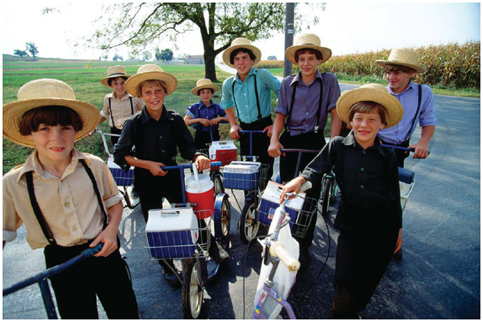 Amish children use scooters to get to school in Lancaster County, Pennsylvania.