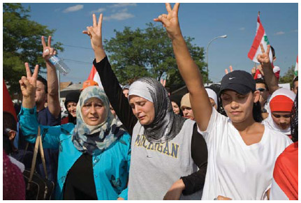 In Dearborn, Michigan, Arab Americans march against Israel's bombing of Lebanon.