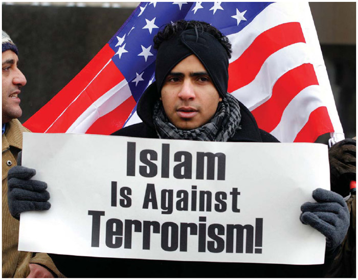 A resident of Dearborn, Michigan, demonstrates in front of the Federal Courthouse in Detroit, Michigan, where suspected terrorist Umar Farouk Abdulmutallab, a 23-year old Nigerian, was arraigned on January 8, 2010. The defendent attempted to blow up