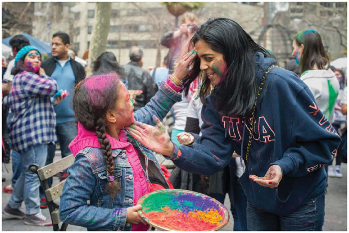 In Dag Hammarskjold Plaza in New York on Sunday, March 31, 2013, the spring holiday of Holi is celebrated by throwing and wearing colored powder.