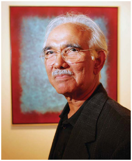 New York artist and Indian expatriate Natvar Bhavsar (1934–) stands in front of one of his works at the Mira Godard Gallery in Toronto, 2005.