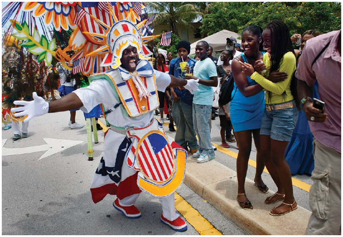 In Coconut Grove, Florida, a traditional Bahamian enclave, people enjoy the Junkanoo parade at the Goombay Festival in 2009. The festival celebrates the legacy of the Bahamian-rooted community.