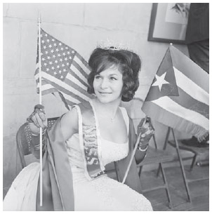 Gladys Gomez, a Bolivian American beauty queen, holds U.S. and Bolivian flags in New York City, 1962.