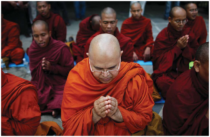 In New York City, Buddhist monks pray for Myanmar victims of Cyclone Nargis outside United Nations headquarters, 2008.