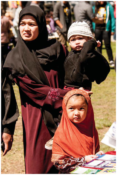 Cambodian American Muslim woman and children at Khmer New Year celebrations in South California.