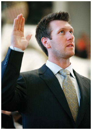 During a naturalization ceremony at Faneuil Hall in Boston, Boston Red Sox left fielder Jason Bay, a native of Canada, takes an oath of citizenship with more than 350 other people in 2009.