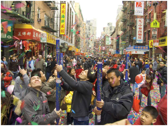 Confetti is blown into the air during the Chinese New year celebration in New York City's Chinatown.