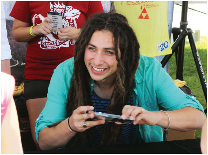 Colombian American singer Jason Castro (1987–) signs CDs in Myrtle Beach, South Carolina, 2013.