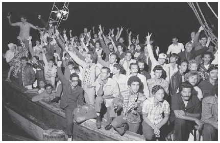 Cuban refugees arrive in the United States in 1980.