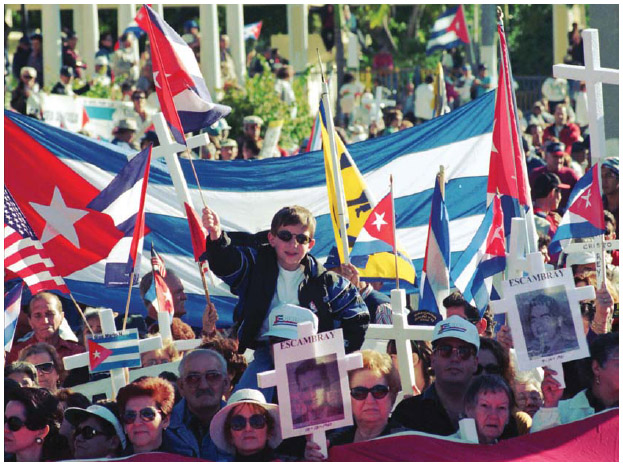 Cuban Americans march in Miami and display crosses representing loved ones who died in Cuba.