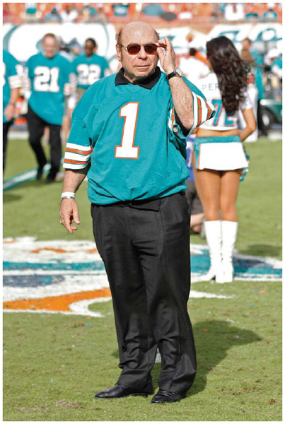 Cypriot American kicker Garo Yepremian, a member of the undefeated 1972 Miami Dolphins, is honored with the rest of the team at a ceremony during halftime of a game in 2012.