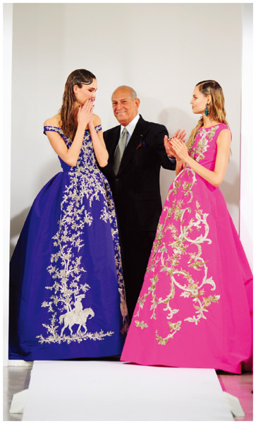 Fashion designer and Dominican American, Oscar de la Renta ©, with models on the runway after his fall 2013 show.