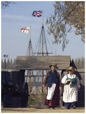 In this 2007 photo, historical interpreters in period dress enter James Fort at Jamestown settlement in Jamestown, Virginia.
