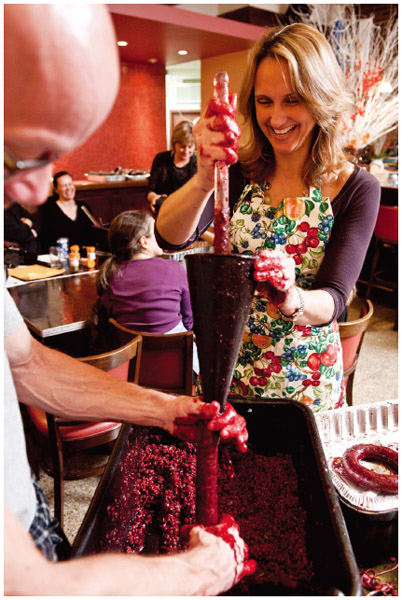 At the Estonian House, in New York, an Estonian American helps to stuff a blood sausage during a party.