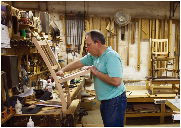 In Amana, Iowa, a worker makes furniture at the Amana Furniture & Clock Shop. The shop was opened when German immigrants established the communal Amana Colonies in 1855.