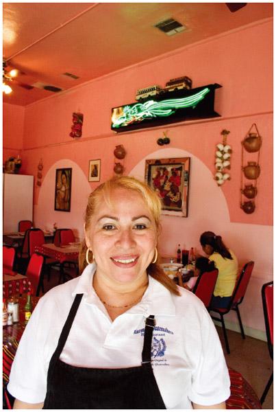 The proprietor of Rinconcito Guatemalteco stands inside the authentic Guatemalan restaurant in Los Angeles, California.