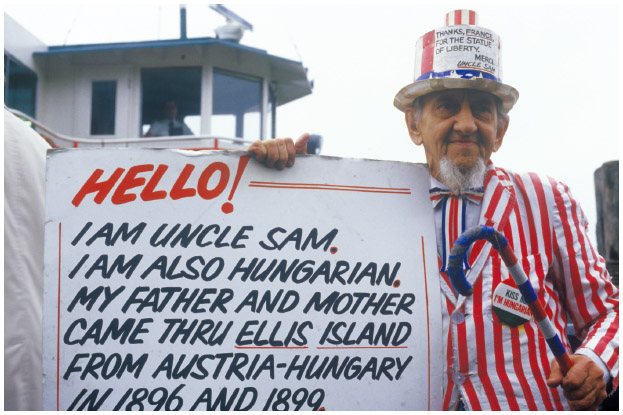 A Hungarian American man wears an Uncle Sam suit to express both his patriotism and Hungarian ancestry.