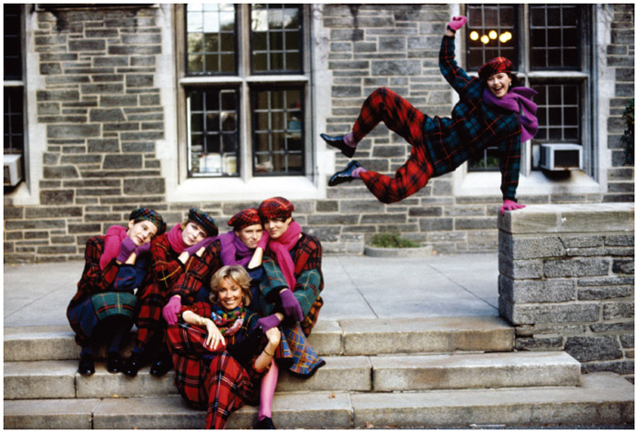 Hungarian-born American fashion designer Adrienne Vittadini (center front) is shown with models dressed in her 1984 fall designs on the grounds of the Cathedral of St. John the Divine, New York, New York, 1984.