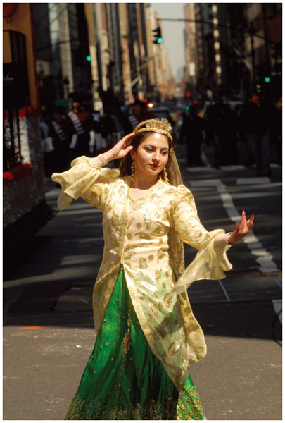 An Iranian American woman dances at the Fourth Annual Persian Parade in New York City. The parade celebrates Nowruz which means New Year in the Farsi language. The holiday symbolizes the purification of the soul and dates back to the-pre Islamic