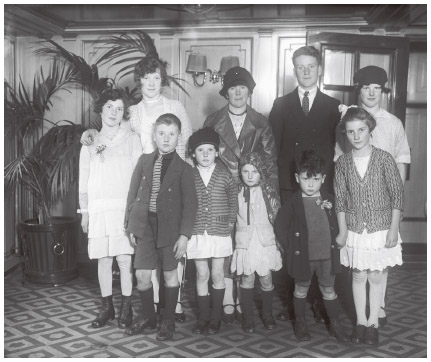 Mrs. Bridget Casey, of County Cork, Ireland, is photographed with her nine children right after arriving in New York. 1929