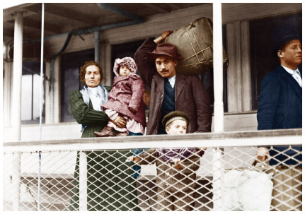 Italian immigrants arrive at Ellis Island, c. 1920.