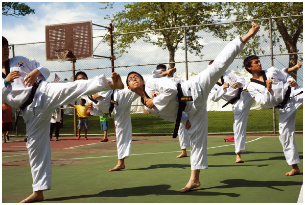 At the Asian American Festival in New York City, Korean American boys practice Tae Kwon Do.