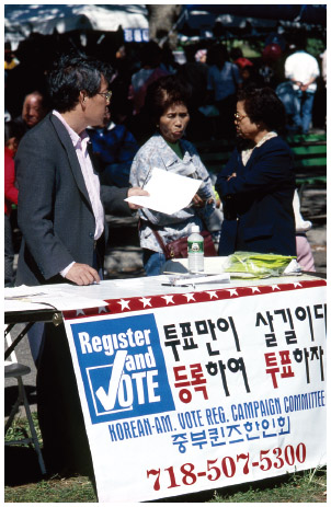 A Korean American voter registration table during an event in New York City.